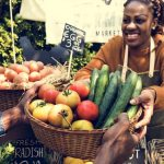 woman selling fresh local vegetables